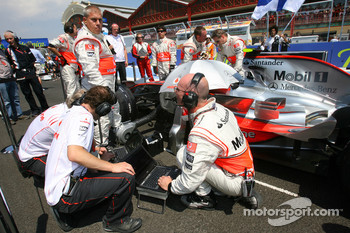 McLaren Mechanics with a computer