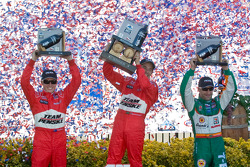 Podium: race winner Helio Castroneves with Ryan Briscoe and Tony Kanaan