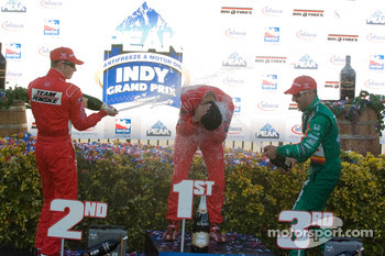 Victory Podium: Helio Castroneves, Tony Kanaan and Ryan Briscoe
