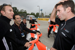 Romain Dumas shares a laugh with Helio Castroneves and Timo Bernhard