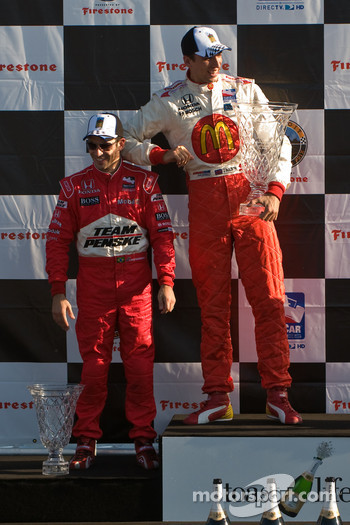 Podium: race winner Justin Wilson and second place Helio Castroneves