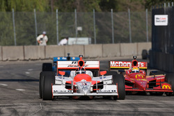 Helio Castroneves leads Justin Wilson