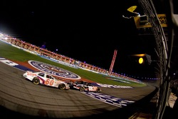Kyle Busch takes the yellow and checkered flags