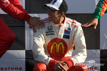 Podium: race winner Justin Wilson shares a laugh with Helio Castroneves and Tony Kanaan