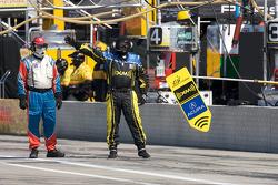 Andretti Green Racing team member signals the #26 car