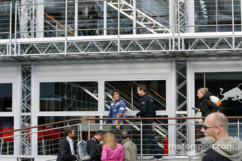Fernando Alonso, Renault F1 Team, goes into red bull motorhome for a chat