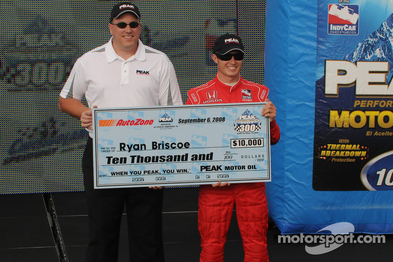 Ryan Briscoe accepts his pole check