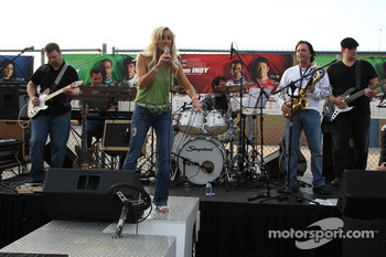 Recording artist Michelle Murphy and her band performs during the celebration party for Father Phil