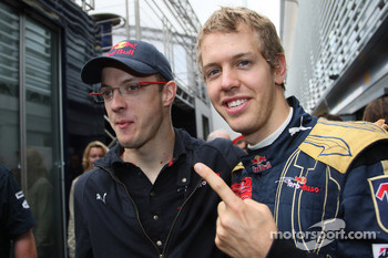 Pole winner Sebastian Vettel celebrates with Sbastien Bourdais