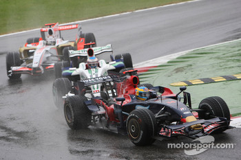 Sébastien Bourdais, Scuderia Toro Rosso, STR03 leads Jenson Button, Honda Racing F1 Team, RA108