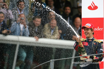 Podium: race winner Sebastian Vettel celebrates with champagne
