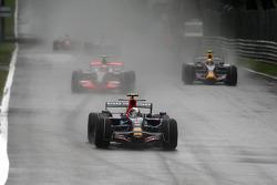 Sebastian Vettel, Scuderia Toro Rosso, STR03 leads Heikki Kovalainen, McLaren Mercedes, MP4-23
