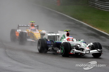 Rubens Barrichello, Honda Racing F1 Team, RA108 leads Nelson A. Piquet, Renault F1 Team, R28