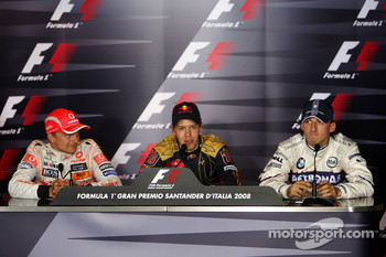 Post-race press conference: race winner Sebastian Vettel, second place Heikki Kovalainen, third place Robert Kubica