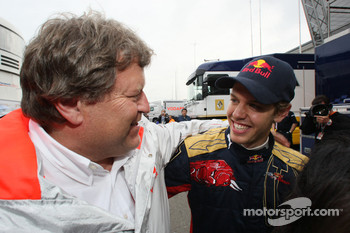 Race winner Sebastian Vettel celebrates with Norbert Haug