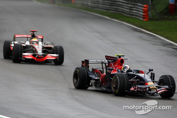 Sebastian Vettel, Scuderia Toro Rosso, STR03 leads Lewis Hamilton, McLaren Mercedes, MP4-23