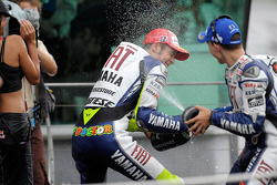 Podium: race winner Valentino Rossi celebrates with champagne
