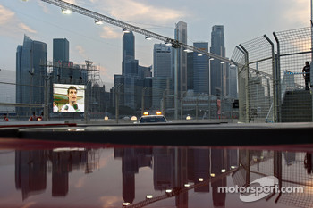 Mark Webber on the video wall and the skyline of Singapore