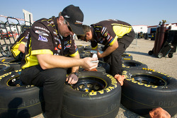 Menards Chevy crew members prepare wheels