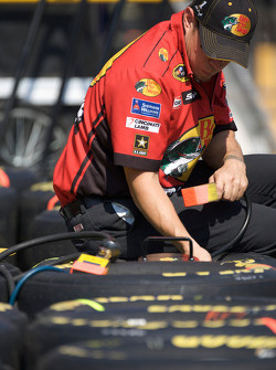 Bass Pro Shops Chevy crew member prepares the wheels