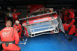 Budweiser Dodge crew member repair the car of Kasey Kahne
