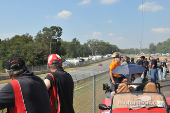 Fans lined up along the back straight
