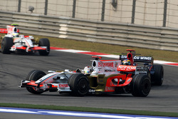 Adrian Sutil, Force India F1 Team, VJM-01 leads Sébastien Bourdais, Scuderia Toro Rosso, STR03