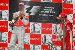 Podium: champagne for Lewis Hamilton and Felipe Massa