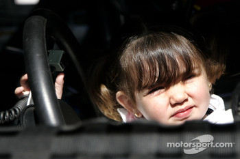 Juan Pablo Montoya's daughter Paulina sits in the Havoline Dodge