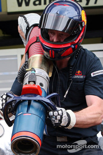 A Red Bull Racing crew member with the fuel nozzle during a pit stop practice