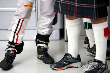 The legs of David Coulthard and a crew member