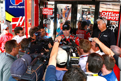 Carl Edwards talks to the media after the end of practice