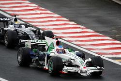Jenson Button, Honda Racing F1 Team leads Nico Rosberg, WilliamsF1 Team