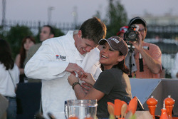 Rachel Ray helps Carl Edwards into his chef uniform