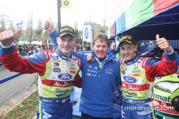 Rally winners Mikko Hirvonen and Jarmo Lehtinen celebrate with Malcolm Wilson