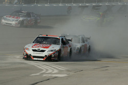 Joey Logano kicks up a dust cloud of speedy dry on the pit lane