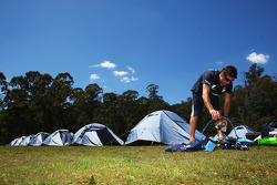 Launceston, Australia: Mark Webber prepares his equipment outside his tent
