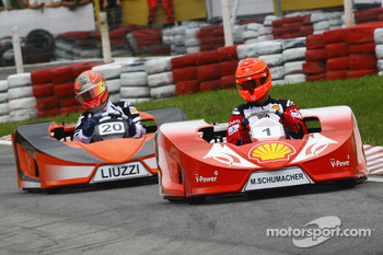 Michael Schumacher, Test Driver, Scuderia Ferrari and Vitantonio Liuzzi, Test Driver, Force India F1 Team