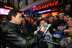 NASCAR Sprint Cup Series champion Jimmie Johnson signs autographs for fans outside the Hard Rock Cafe in Times Square