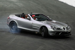 Lewis Hamilton gives his father Anthony a ride around the track in the McLaren Mercedes SLR