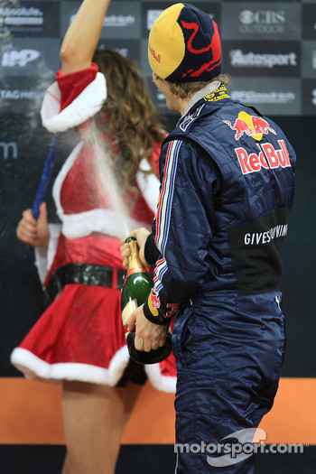 Podium: Sebastian Vettel sprays champagne