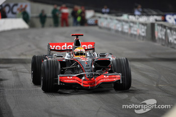 Lewis Hamilton shows off his McLaren Mercedes F1 car for the crowd
