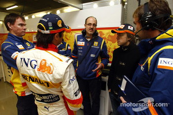 Nelson A. Piquet and Fernando Alonso talk with members of the RenaultF1 team