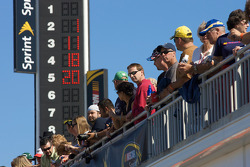 Fans watch garage activity during the practice session