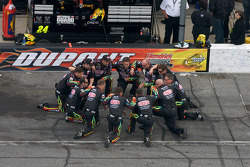 Hendrick Motorsports Chevrolet crew of Jeff Gordon confers after National Anthem