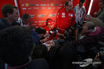 Kimi Raikkonen, Scuderia Ferrari, talks with the media after the race