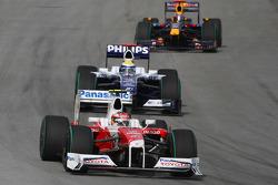Timo Glock, Toyota F1 Team and Nico Rosberg, Williams F1 Team