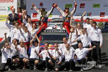 Podium: winners Sébastien Loeb and Daniel Elena celebrate with Citroen Total World Rally Team