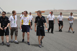 Sebastian Vettel, Red Bull Racing after his arrival on the track walk with his team gets overtaken by Jenson Button, Brawn GP on his walk with Ross Brawn Brawn GP Team Principal