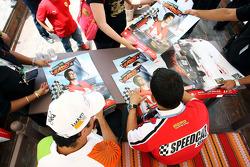 Vitantonio Liuzzi UP Team and Gianni Morbidelli sign autographs for the fans